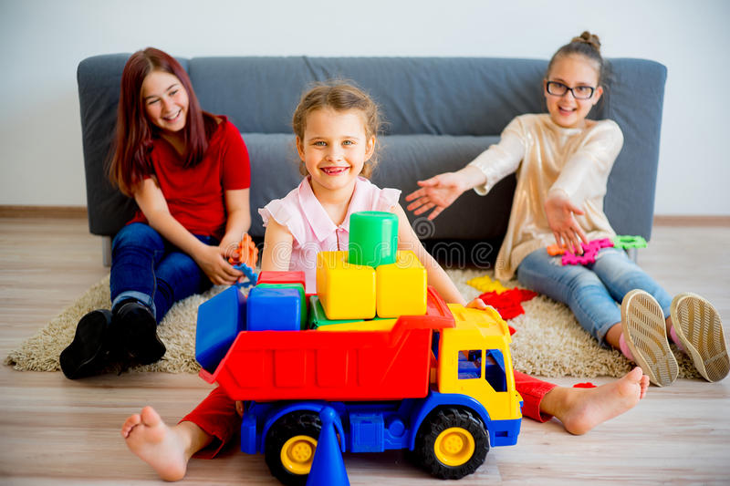 Girl playing with toy truck royalty free stock photography