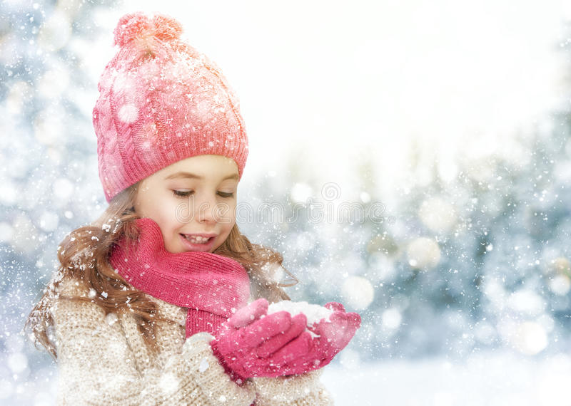 Girl playing on a winter walk stock images