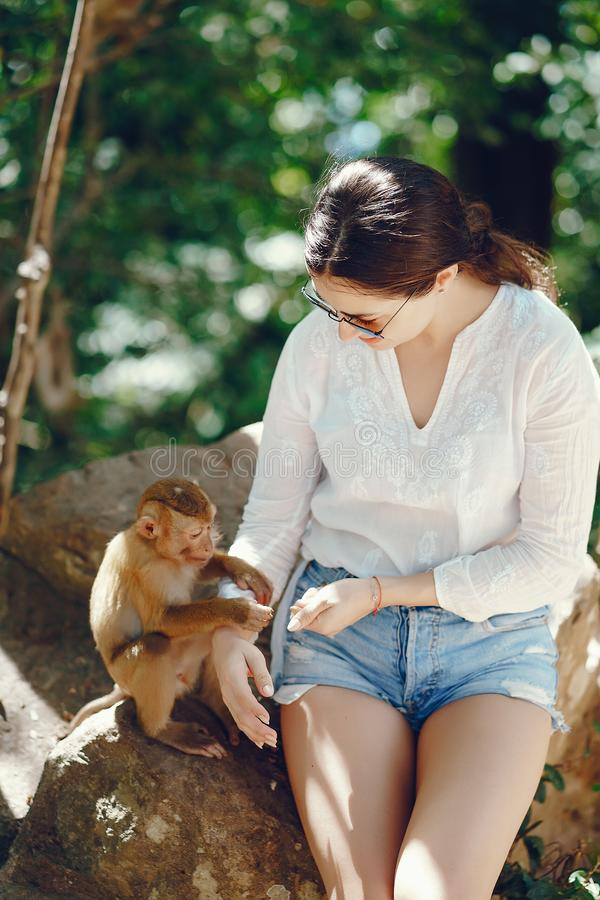 Free Girl Playing With Monkey Royalty Free Stock Photography - 122767537