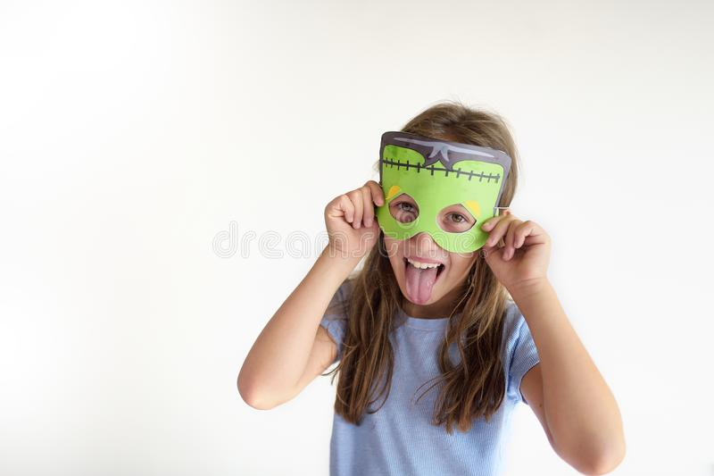 The girl plays the fool in a mask of the monster royalty free stock image