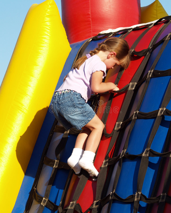 Girl Plays Inflatable Bouncy royalty free stock image