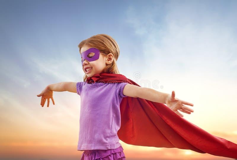 Girl plays superhero royalty free stock images