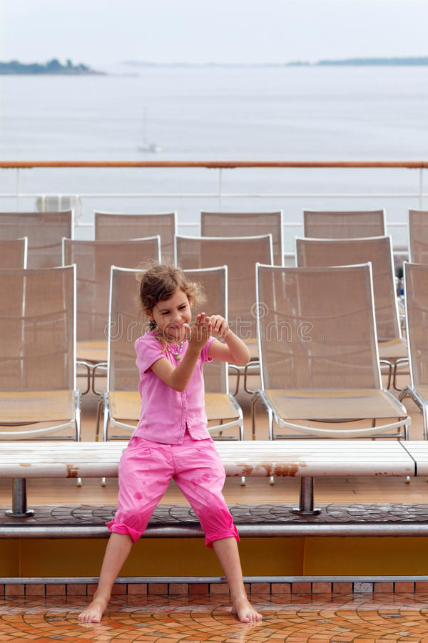 Download Girl Plays With Water On Deck Of Ship. Stock Photo - Image: 26281752