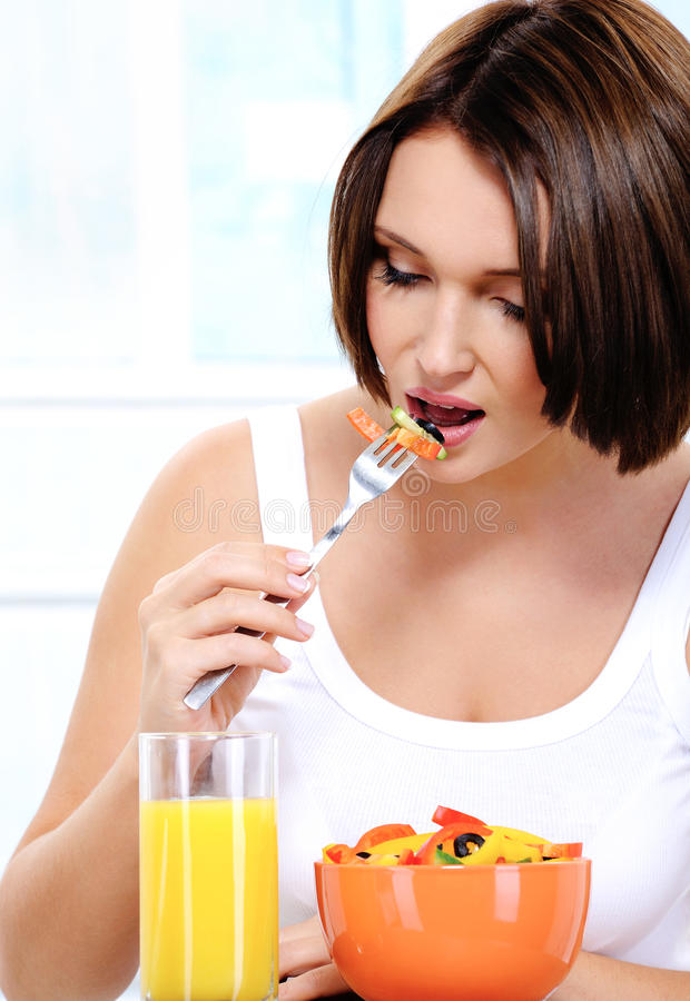 Download Girl Of Pleasant Appearance Eats Vegetable Salad Stock Photo - Image: 11711418