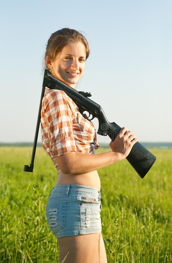 Girl with pneumatic air rifle. Girl holding pneumatic pneumatic air rifle outdoor stock photo