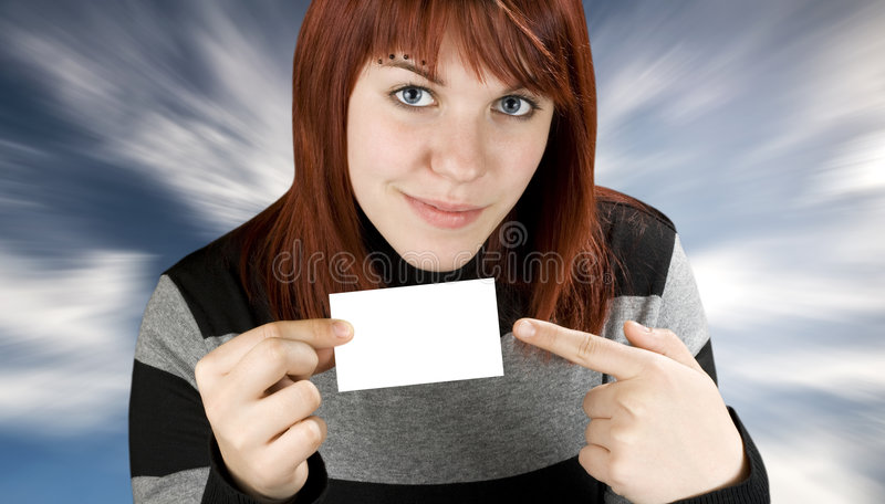 Girl pointing at a blank business card stock photography