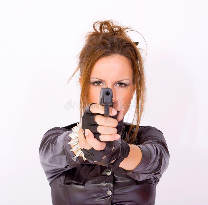 Girl pointing a gun stock photography
