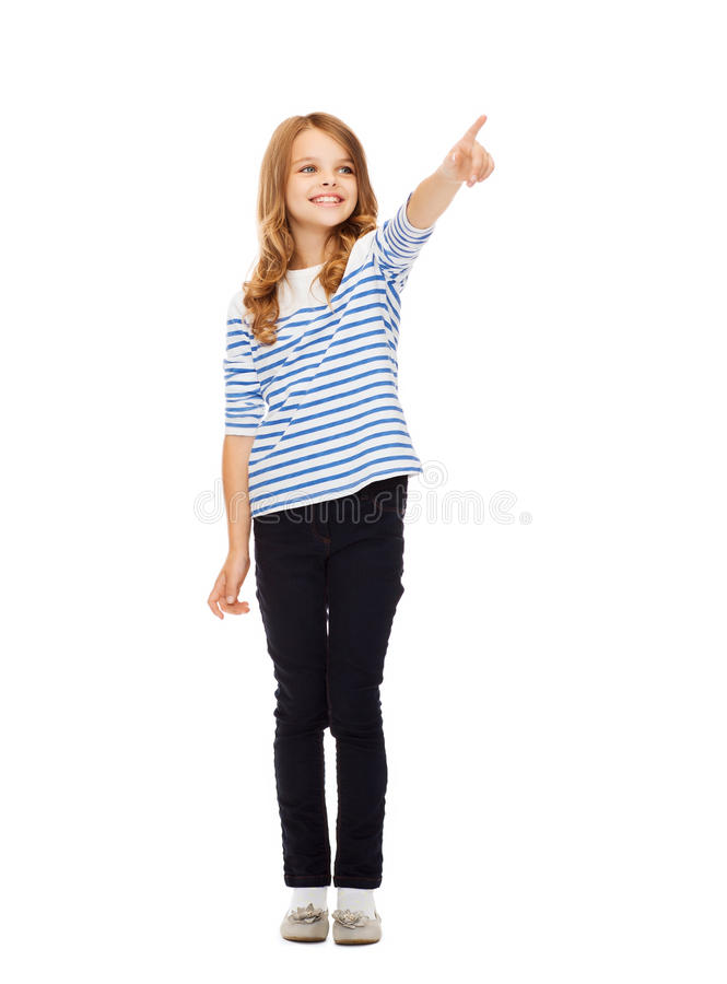 Girl pointing at imaginary screen stock photos