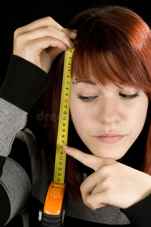 Download Girl Pointing At A Measuring Tool Stock Photo - Image: 3742828