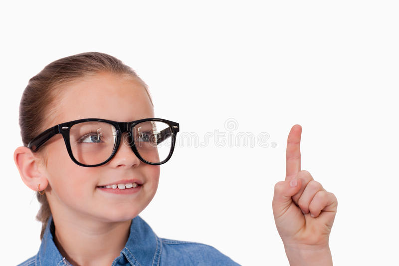 Girl pointing at something. Against a white background stock images