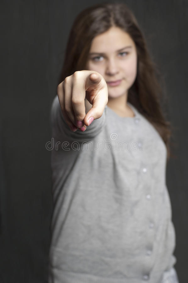 Girl is points on you stock images