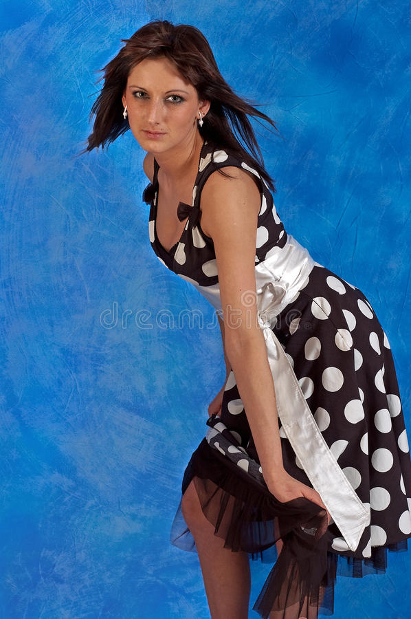 Girl in polka-dot dress royalty free stock images