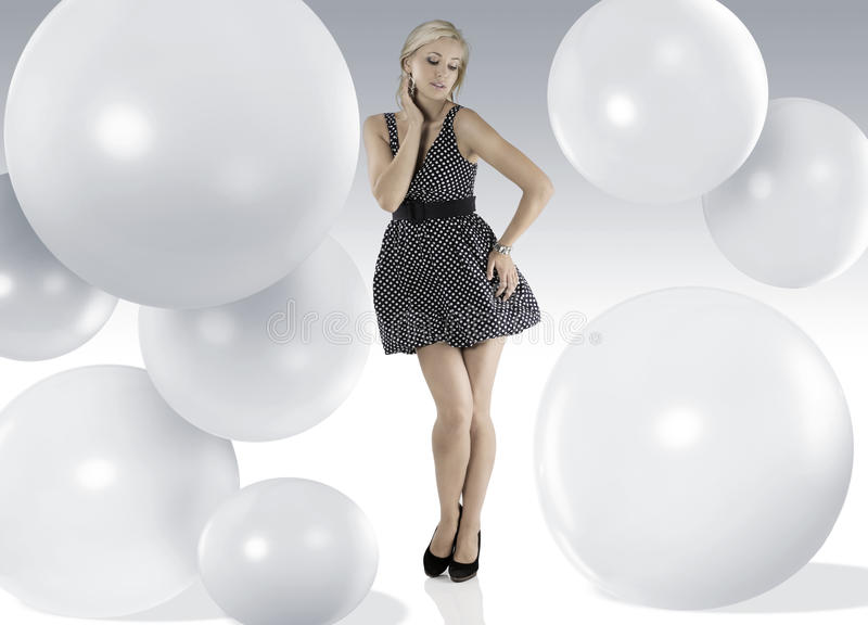 Girl with with polka dots stock photography