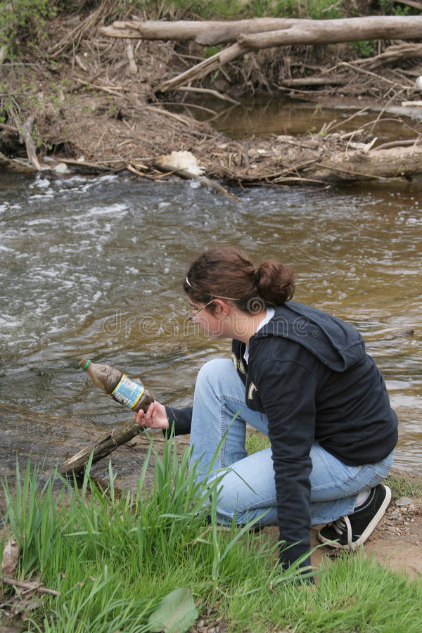 Girl At Polluted Creek Stock Images