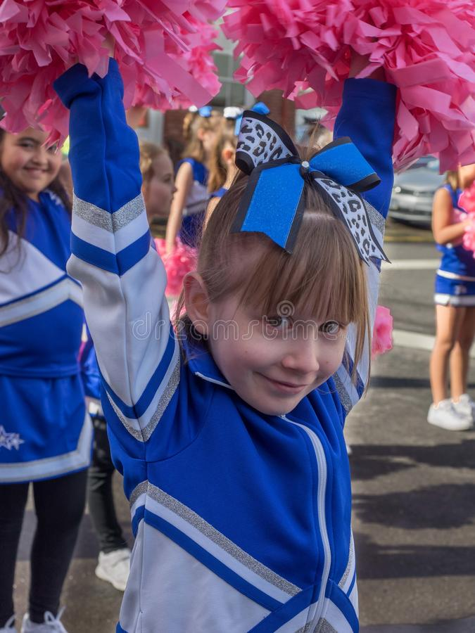 Girl with pompoms in a parade stock image