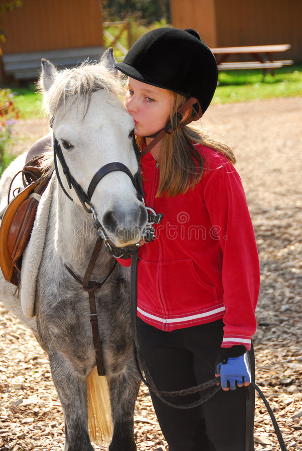 Girl and pony royalty free stock photography