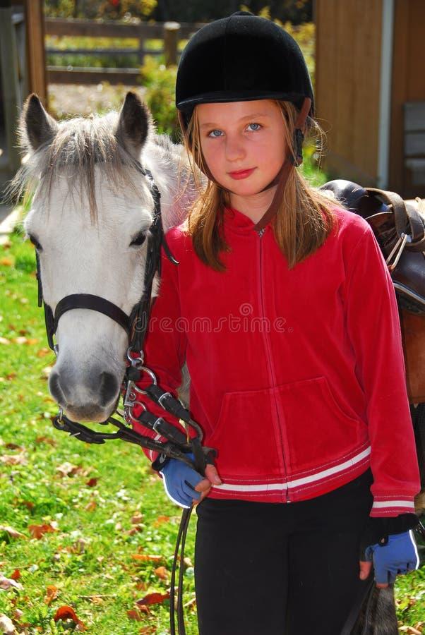 Girl and pony stock photos
