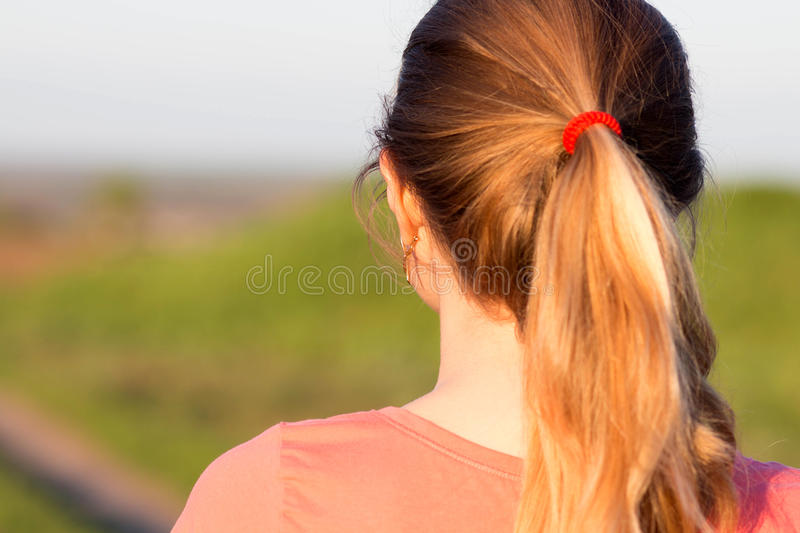 Girl with a ponytail hairstyle for sports stock images