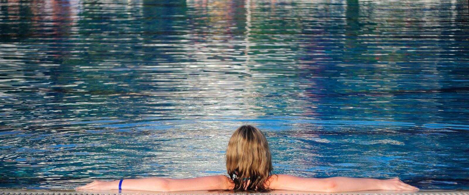 The girl in pool stock images