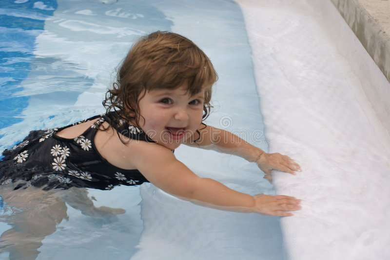Girl in a pool royalty free stock photos