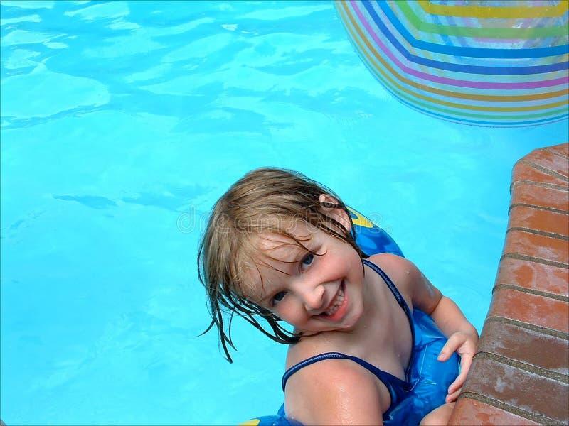Girl in pool. Cute girl swimming in a pool stock image