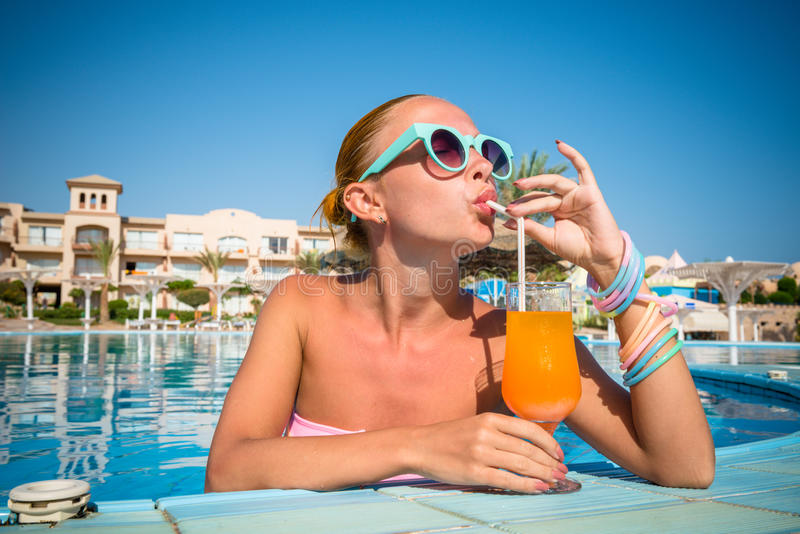 Girl in pool bar. At tropical tourist resort vacation destination royalty free stock photos