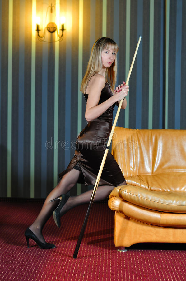 Girl with a pool cue stock images