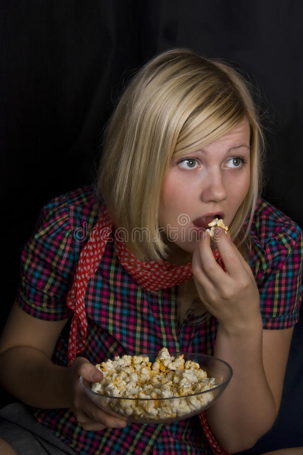 Girl with popcorn stock images
