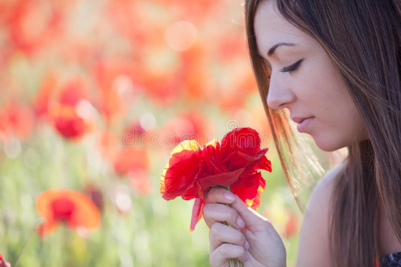 Download Girl With Poppies Bunch Royalty Free Stock Image - Image: 14414046