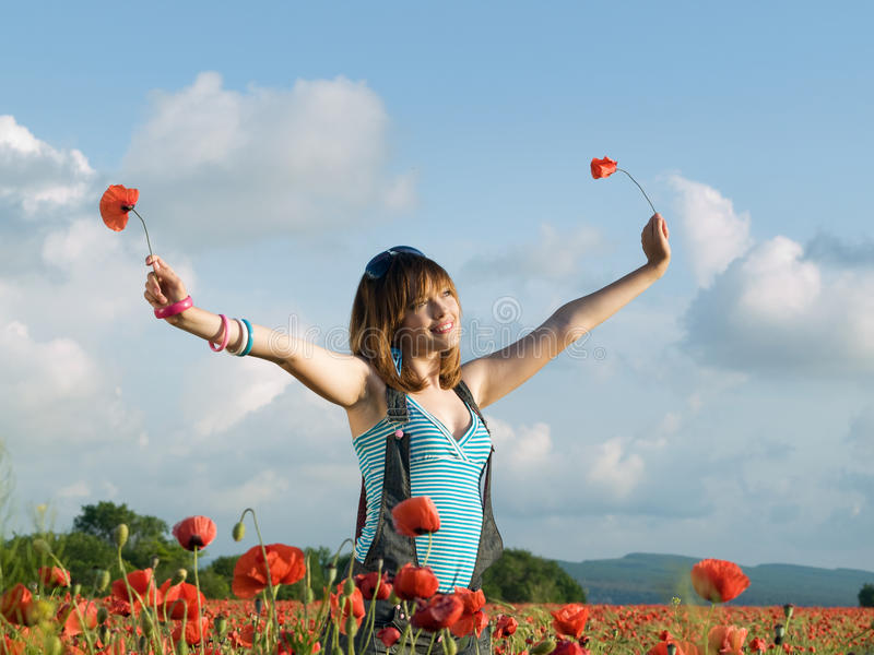 Download Girl in poppy field stock photo. Image of outdoors, happy - 24073680