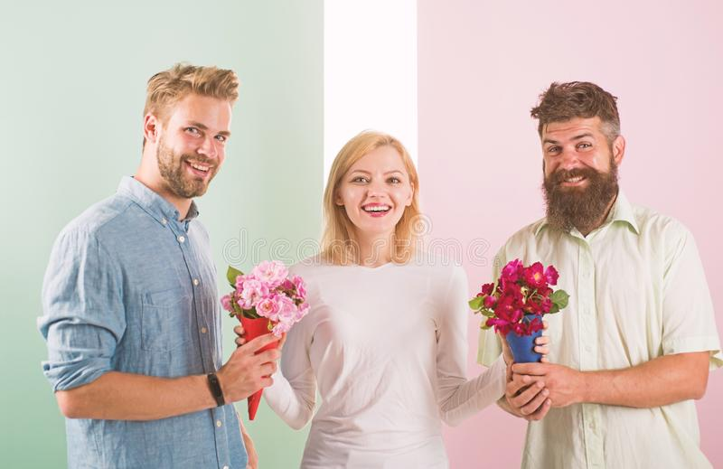 Girl popular receive lot men attention. Girl happy likes gifts. Love triangle. Men competitors with bouquets flowers try. Conquer girl. Woman smiling can not stock photos