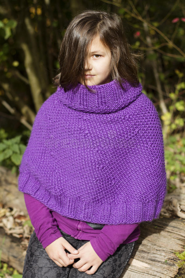 The girl. The portrait of a teenage girl wearing purple poncho stock photos