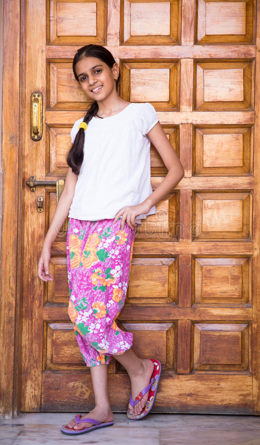 Girl posing against a wooden door royalty free stock photos