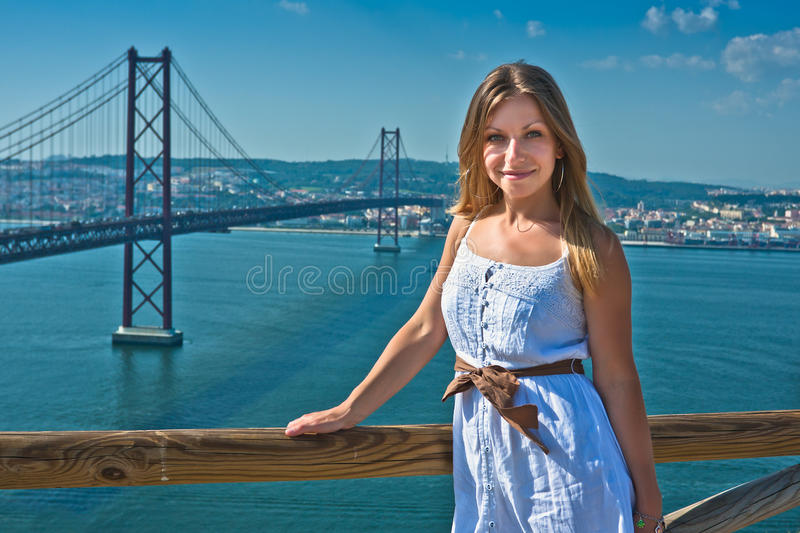Download Girl Posing And The April 25 Bridge In Lisbo Stock Photo - Image: 21980650