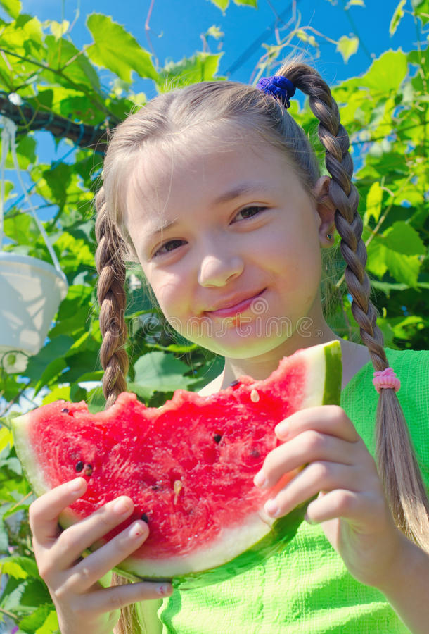 Free Girl Posing Eating Watermelon Royalty Free Stock Photo - 75427375