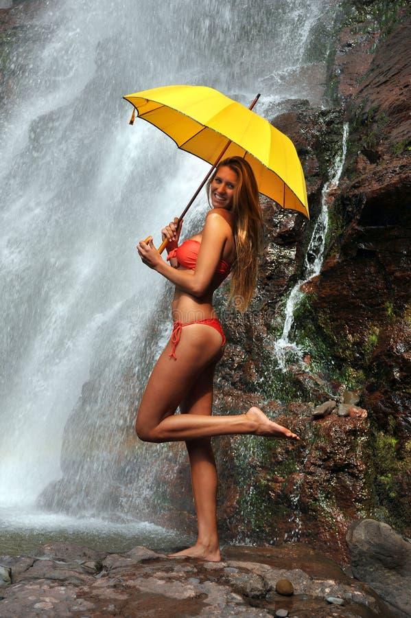 Girl posing in front of waterfalls