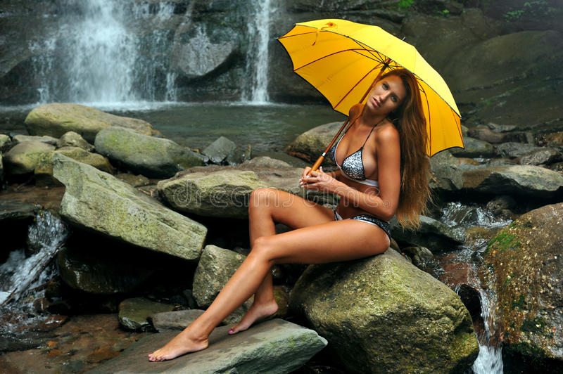 Download Girl Posing In Front Of Waterfalls Royalty Free Stock Images - Image: 33310479