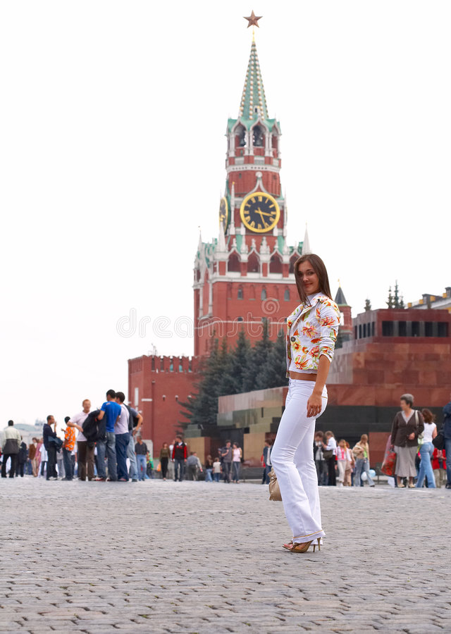 Girl posing in Moscow. Young woman posing in square in Moscow royalty free stock photos