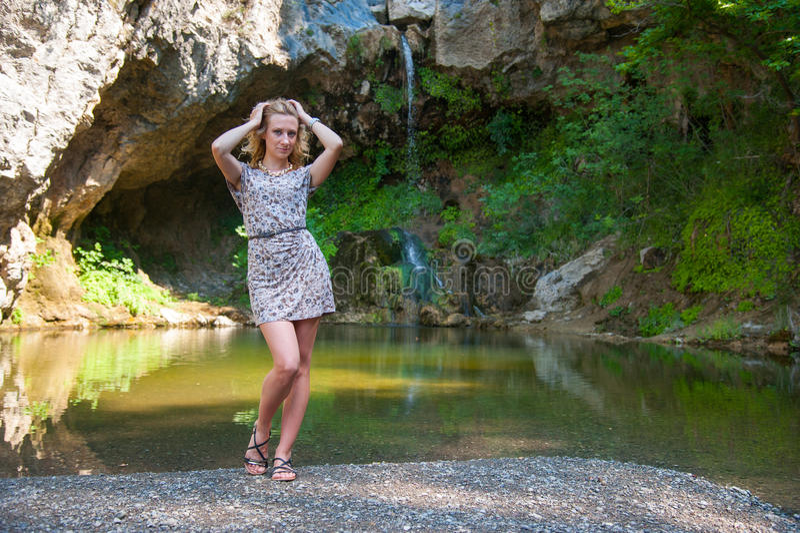 Girl Posing Near Small Lake stock image