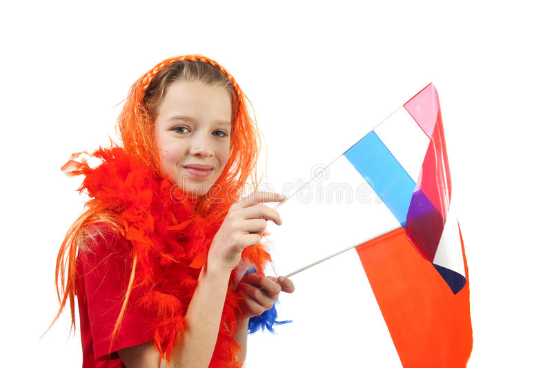 Girl is posing in orange outfit for soccer game stock photography