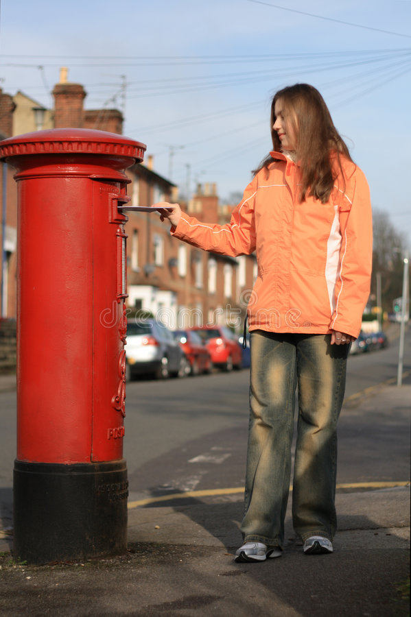 Download Girl Posting Letter To Red British Postbox Stock Photo - Image: 1958866
