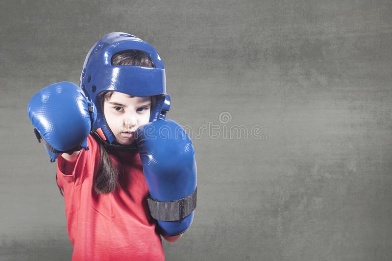 Girl power concept. With determined little fighter stock photo