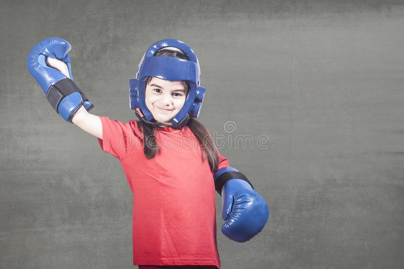 Girl power concept. With determined little fighter royalty free stock image