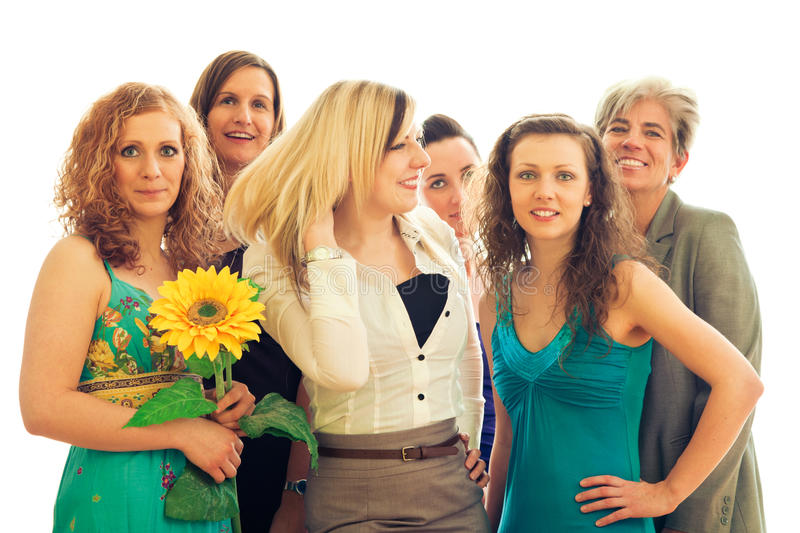 Girl Power!. A group of six women aged approx 20-55, wearing different styles of clothes and posing in front of a white background stock photography