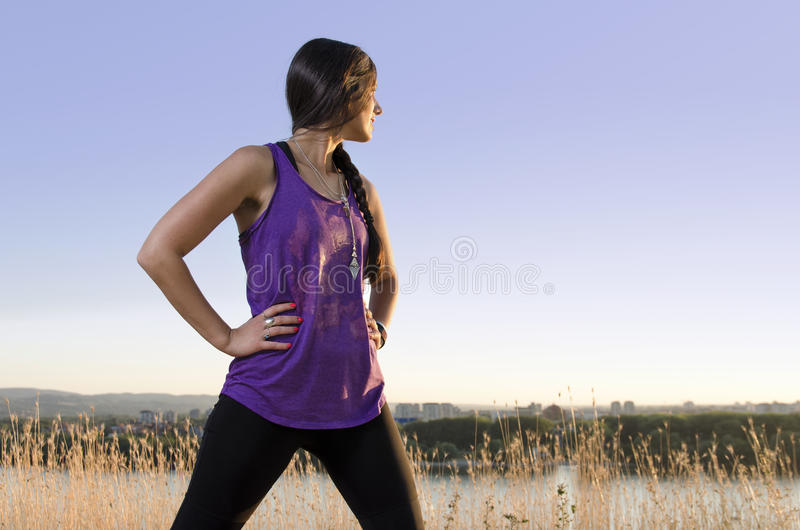 Girl power, powerful woman standing in power pose outdoors stock photo