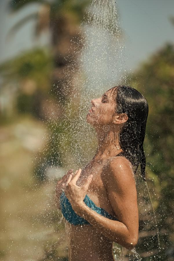 Girl Powered. Issues face girls. Water drops falling on attractive woman. Young beautiful brunette girl taking shower on stock image