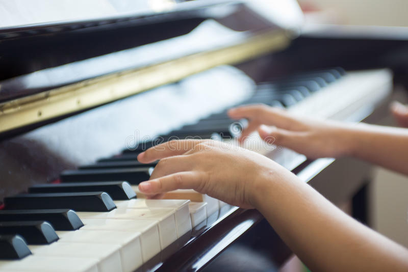 girl practices piano lesson royalty free stock photography