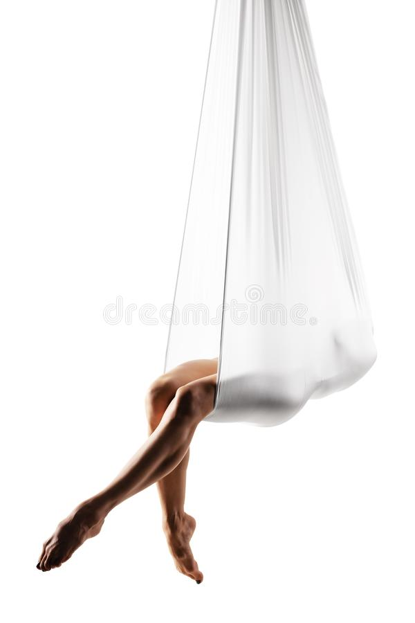 Girl practicing aerial yoga stock photo