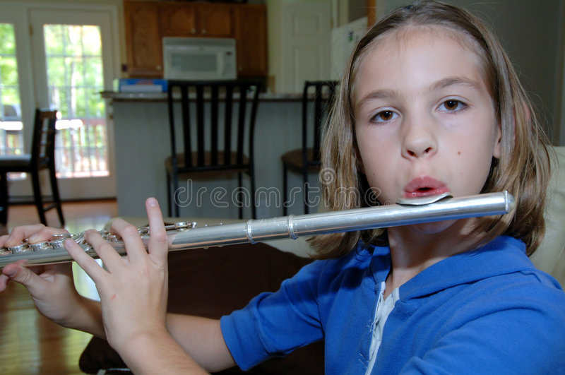 Download Girl Practicing Flute At Home Stock Photo - Image: 6829388