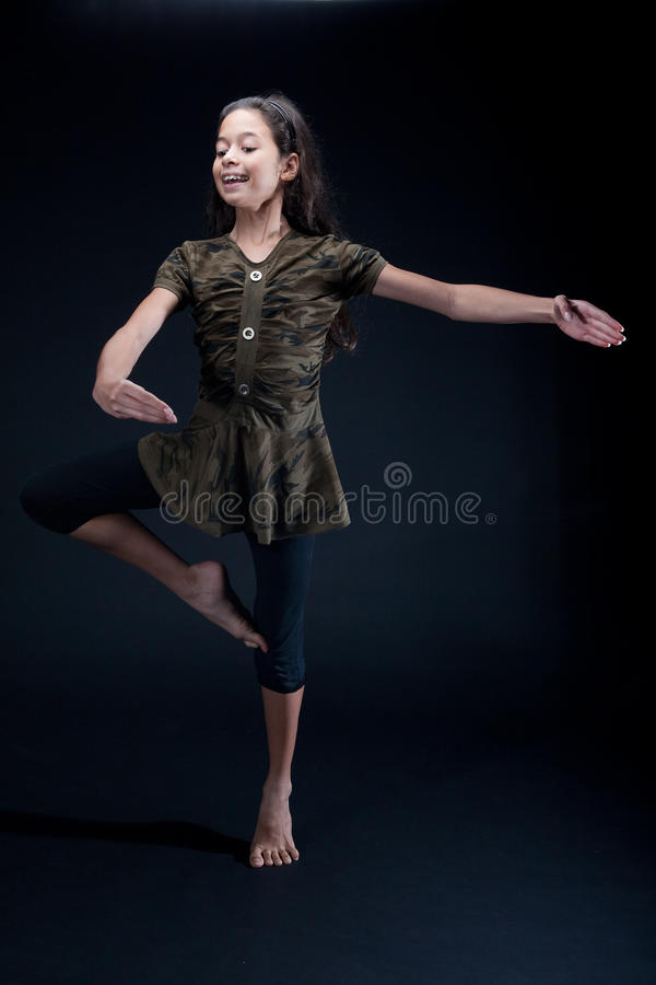 Girl practising her ballet pose royalty free stock image